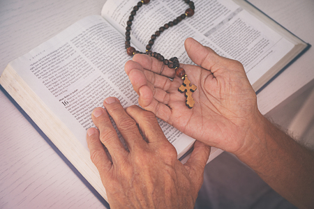 Old man reading the Bible