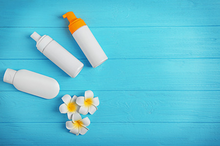 Sun protection lotions on wooden background Stock Photo