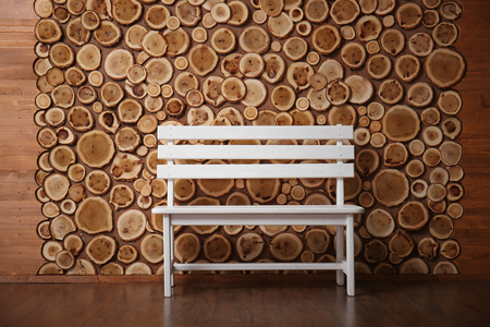 White bench on round timber background
