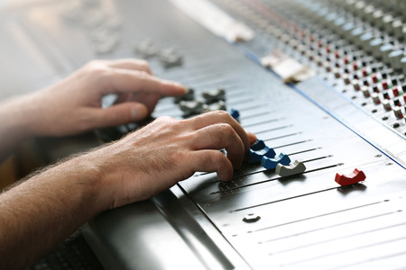 Hands on mixer in a recording studio, close up 스톡 콘텐츠