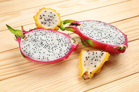 Dragon fruits on wooden background 写真素材