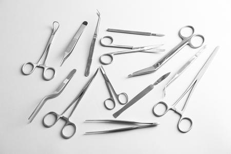 Flat lay of medical instruments on white background 스톡 콘텐츠