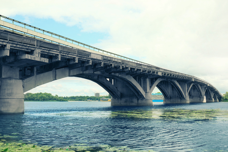 Concrete bridge over river Stock Photo