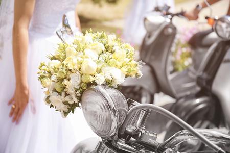 Wedding concept. Beautiful bouquet on scooter, closeup