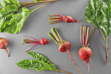 Young beets on grey background
