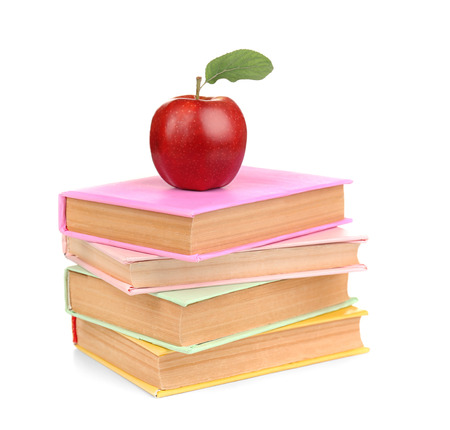 Apple with books, isolated on white. Back to school concept