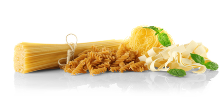 Different kinds of dry pasta, isolated on white