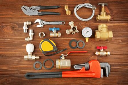 Plumber tools on a wooden background 版權商用圖片