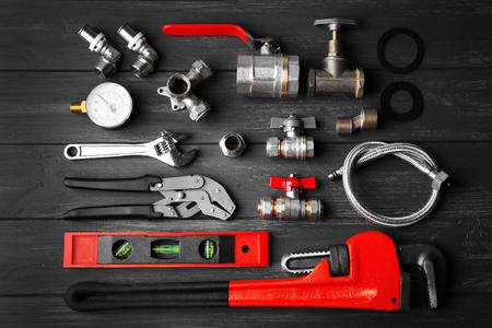 Plumber tools on a gray wooden background 版權商用圖片