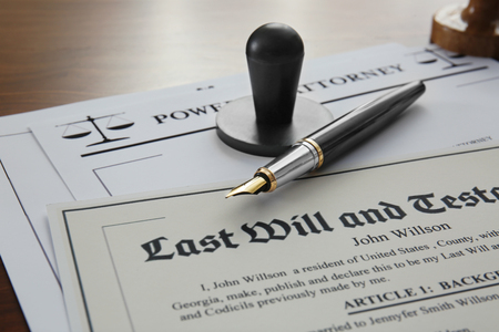 Pen, stamp and documents on notary public table