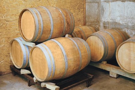 Wooden barrels for wine in cellar Stock Photo