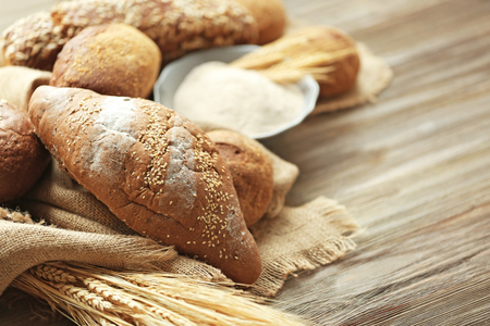 Rye bread with sesame seeds and spikes on a wooden table Stock Photo