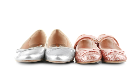 Family concept. Shoes for mother and daughter on white background