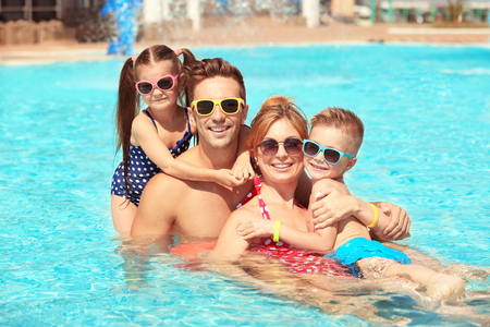 Happy family in swimming pool at water park Stock Photo