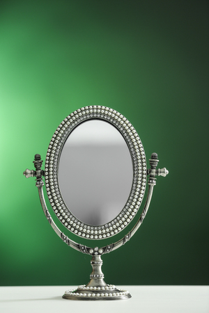 Female mirror on color background Stock Photo