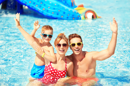 Happy family in swimming pool at water park Stockfoto