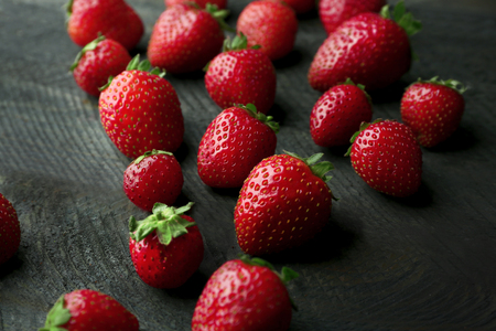 Fresh strawberries on dark wooden background