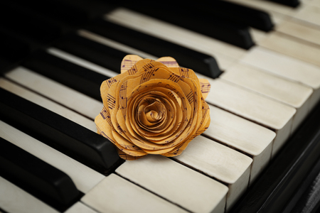 Rose made of music notes on piano keys 스톡 콘텐츠