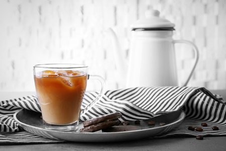 Iced coffee with milk on silver plate Archivio Fotografico