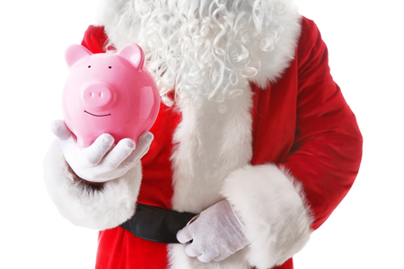 Santa Claus hand holding piggy bank on white background Standard-Bild