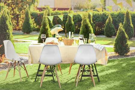 Table with food and drinks served for picnic