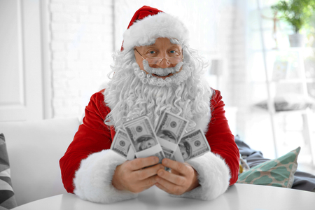 Santa Claus with money at home