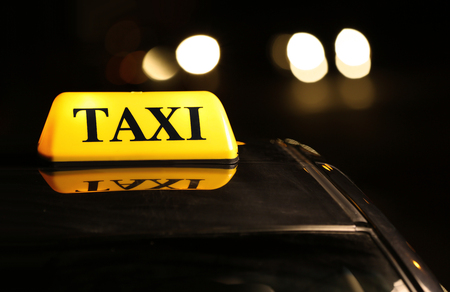 Yellow taxi roof light at night