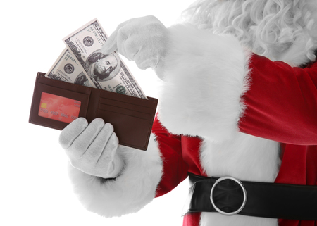 Santa Claus hands holding wallet with money and credit card on white background
