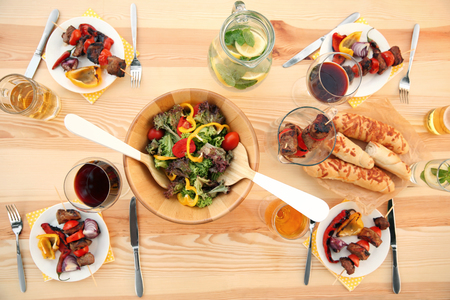 Table served with food and drinks for barbecue picnic, top view Stock Photo
