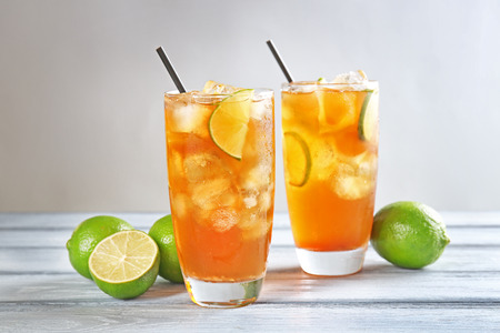 Glasses of iced tea with lime slices on table Stock Photo
