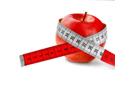 Dieting concept. Red apple with measuring tape isolated on white Zdjęcie Seryjne