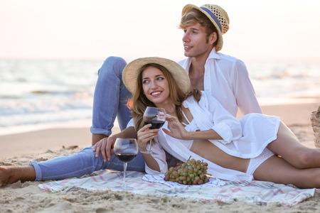 Young happy couple having date on seashore
