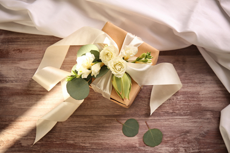 Handcrafted gift box with flowers on wooden table 写真素材