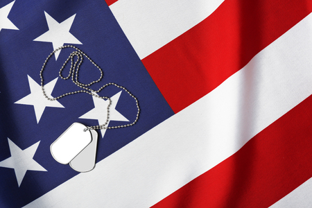Military ID tags on USA flag background Stock Photo