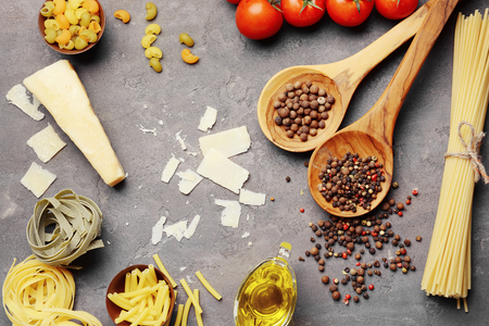 Pasta and products on color background Imagens