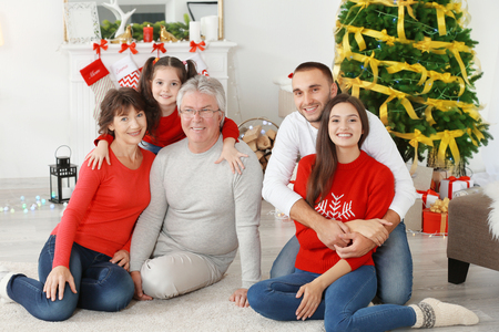 Happy family in living room decorated for Christmas Stock Photo