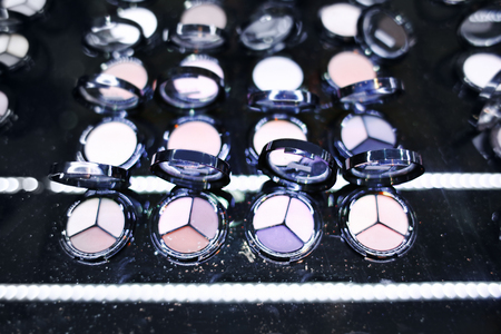 Assortment of different colourful eye shadow palettes in cosmetic store 写真素材 - 107790570