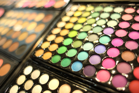 Assortment of different colourful eye shadow palettes in cosmetic store 写真素材 - 107794742