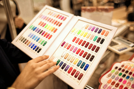 Set of different nail polish colours on palette in cosmetic store Stock Photo - 110482792