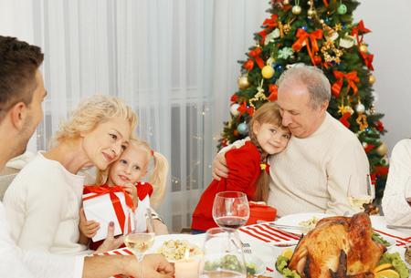 Happy family having Christmas dinner in living room 스톡 콘텐츠 - 109499227