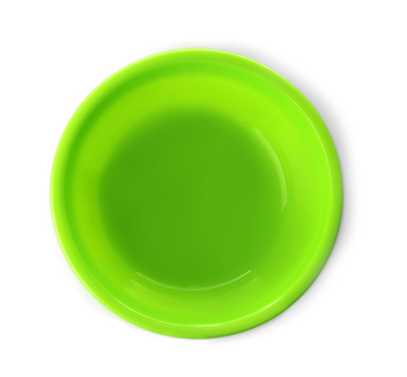 Bright plastic plate for child on white background