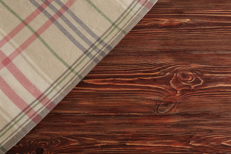 Cozy soft plaid on wooden background