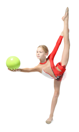 Young girl doing gymnastics with ball, isolated on white Stockfoto