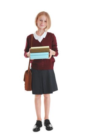 Colegiala con libros y bolso aislado en blanco