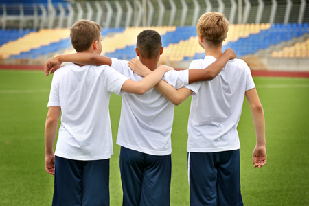 Happy football players at stadium
