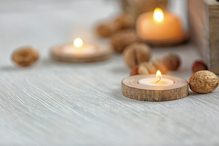 Candle in wooden holder, closeup