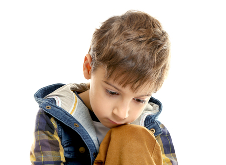 Portrait of little thoughtful boy isolated on white