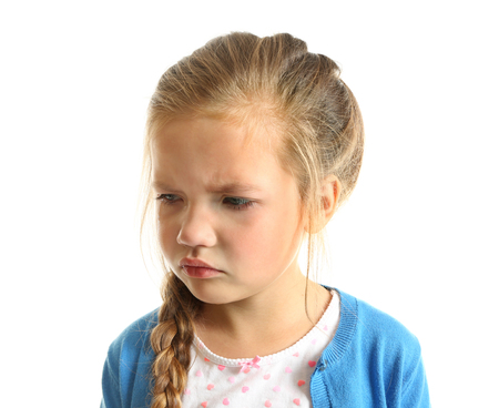 Portrait of crying little girl on white background Stock Photo