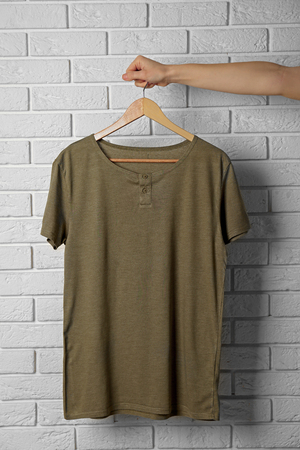 Blank color t-shirt against brick wall