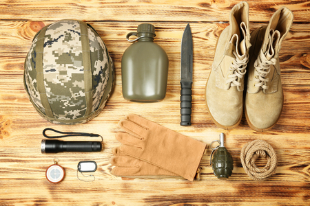 Military equipment on wooden background